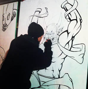 Artist Gully Elusive during a live draw in Digbeth